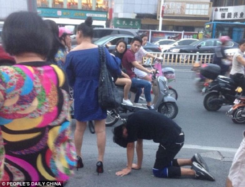 Bizarre sighting: The man was seen crawling on his hands and knees along the busy road