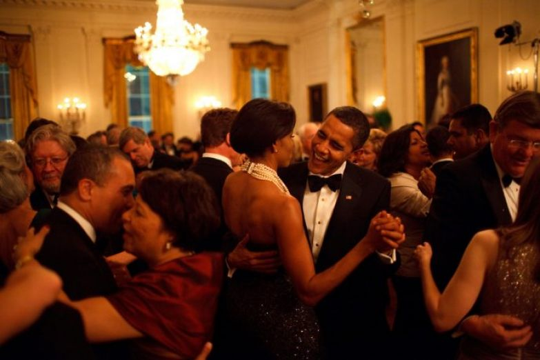 President Barack Obama and First Lady Michelle Obama dance while the band Earth, Wind and Fire performs at the Governors Ball in the State Dining Room of the White House 2/22/09. Official White House Photo by Pete Souza
