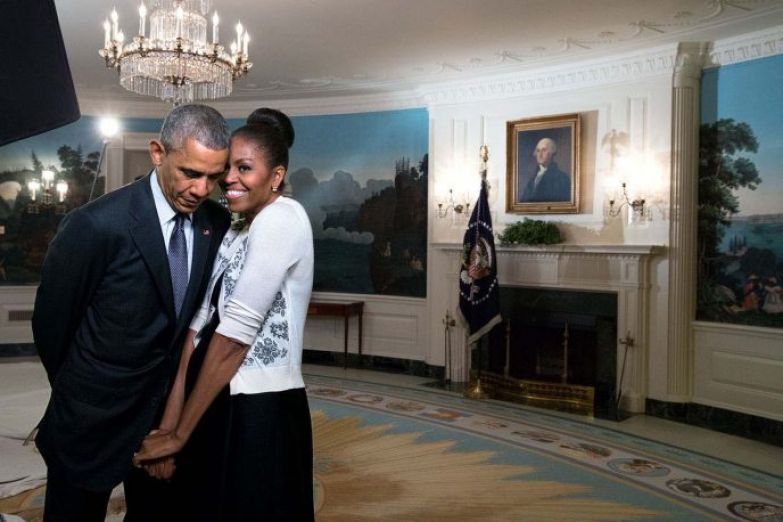 """March 27, 2015 """"The First Lady snuggled against the President during a video taping for the 2015 World Expo in the Diplomatic Reception Room of the White House."""" (Official White House Photo by Amanda Lucidon) This official White House photograph is being made available only for publication by news organizations and/or for personal use printing by the subject(s) of the photograph. The photograph may not be manipulated in any way and may not be used in commercial or political materials, advertisements, emails, products, promotions that in any way suggests approval or endorsement of the President, the First Family, or the White House."""