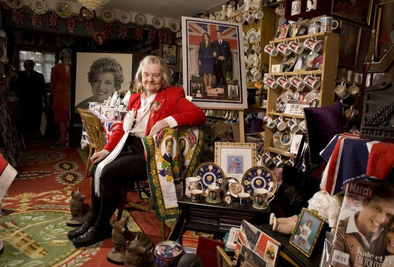 Margaret Tyler, poses with her collection of Royal memorabilia in the country at her home in Wembley, London. Tyler has amassed the largest collection of Royal memorabilia in England, including items for the wedding of Prince William and Kate Middleton.